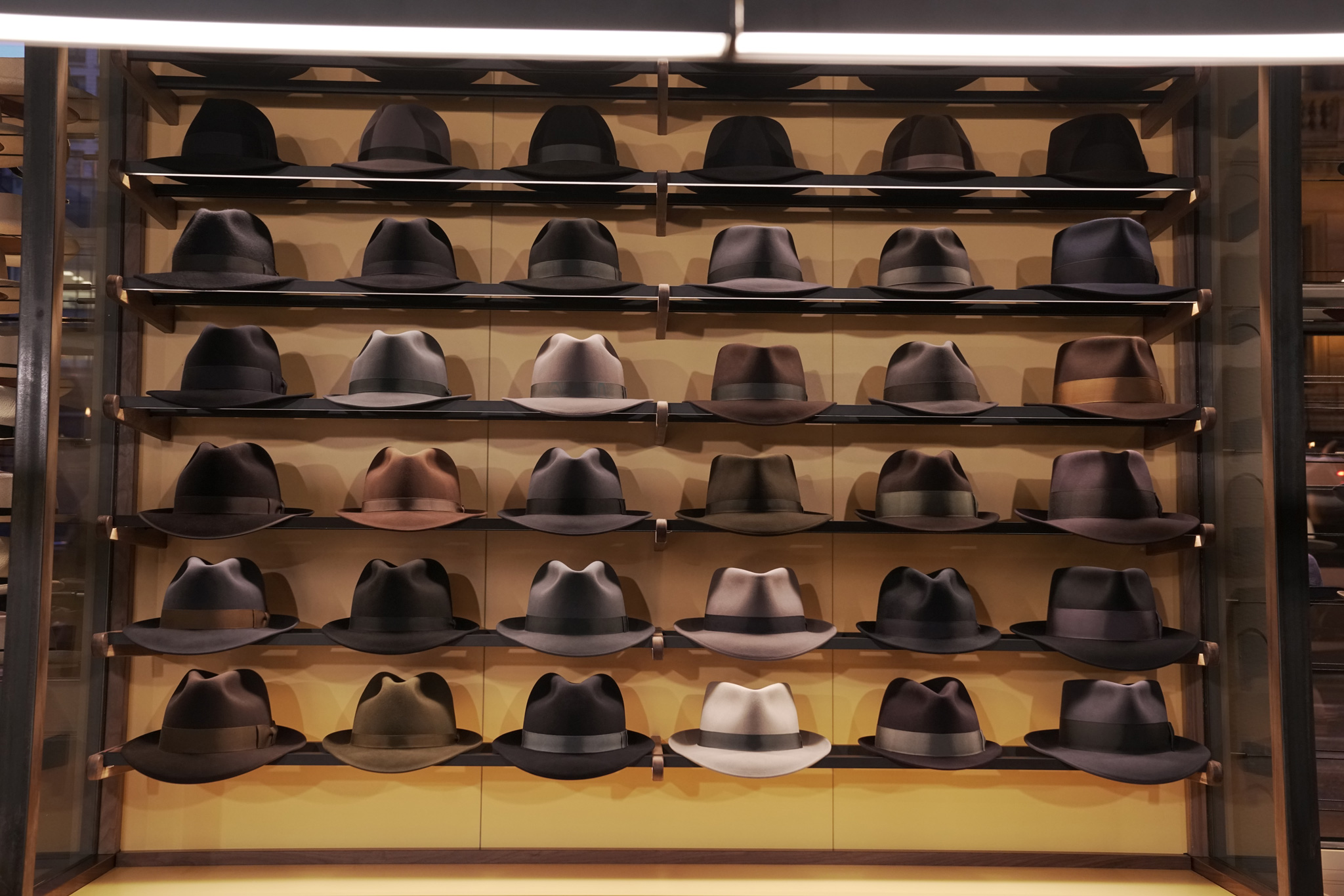 894838dd535 Hats arrayed on shelves at Optimo Hats