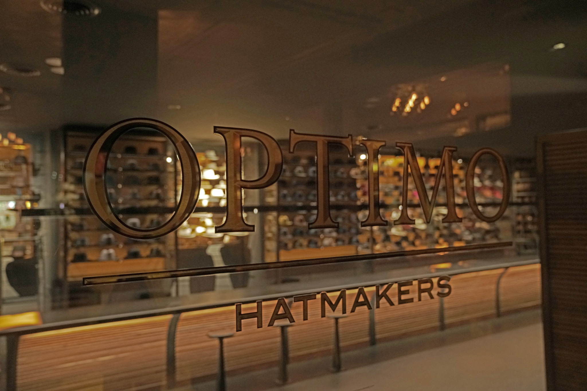 f44538d2b8a The Optimo Hats sign on the glass in their Chicago South Side store.