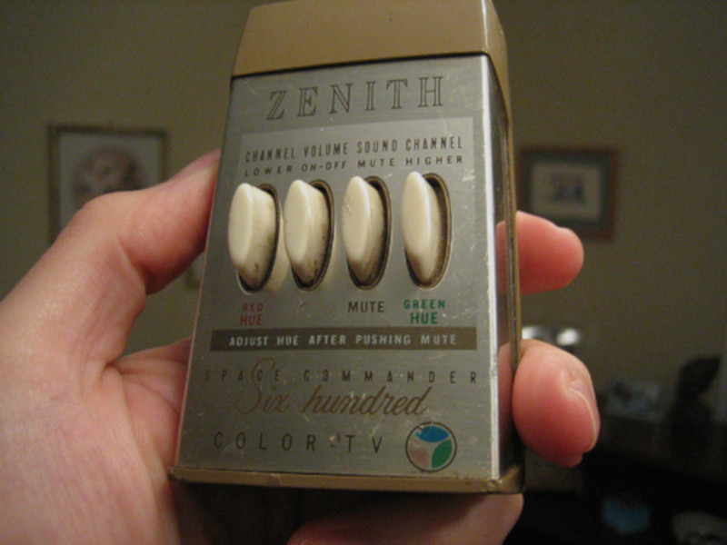 A Zenith Space Command 600 remote control in someone's hand